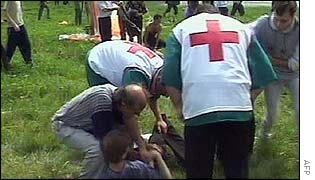 Medics tend a wounded victim