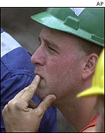 Pensive rescuers in Pennsylvania