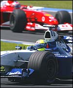 Ralf Schumacher finished third, while Rubens Barrichello dropped back to fourth after a refuelling problem