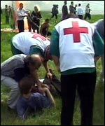 Aid workers help the injured, some of them in a critical condition