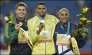 Claston Bernard is flanked by Australia's Matt McEwen and Scotland's Jamie Quarry at the medal ceremony