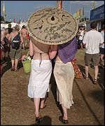 Festival goers with a parasol