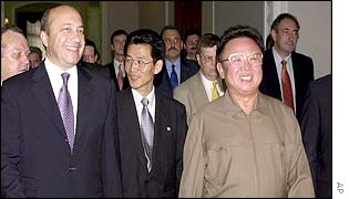 Russian Foreign Minister Igor Ivanov walks with North Korean President Kim Jong-il