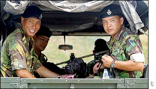 Brunei soldiers and sniffer dog