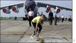 Flowers are laid at the ceremony at the Sknyliv base
