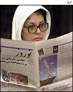 Iranian woman reading a newspaper