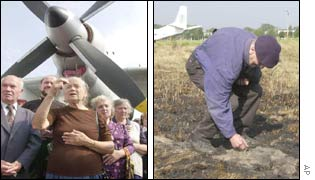 People pray at the site of the crash (l); a survivor examines the charred ground (r)