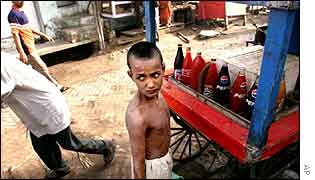 Boy selling drinks   AP