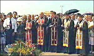 Priests lead a ceremony at the crash site