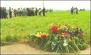 Flowers lay near the site of the crash