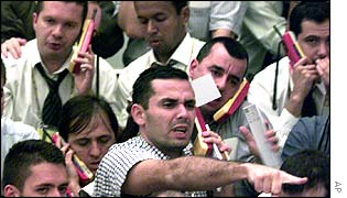 Traders work in the dollar pit at the BM&F futures and commodities market in Sao Paulo, Brazil on Monday July 29, 2002.