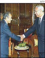 Colin Powell (right) with Malaysian Prime Minister Mahathir Mohamad