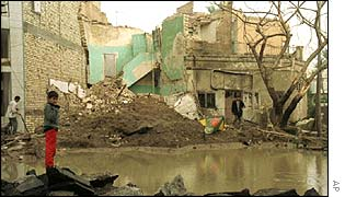 An Iraqi child stands amid the rubble which was left after a 1998 missile attack on Baghdad