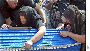 Relatives of one of the killed during the funeral ceremony at a Lviv cemetery