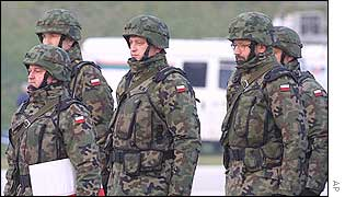Polish troops patrol the border