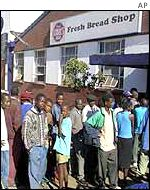 People queuing for food in Zimbabwe