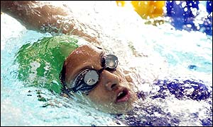 12-year-old Kiran Khan finishes seventh in her 100m backstroke heat, failing to qualify for the semi-finals