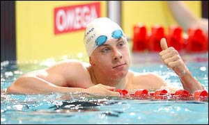Adam Whitehead shows his delight at reaching the semi-finals of the 100m breaststroke with the second fastest time