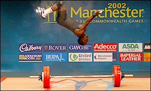 Cameroon's Tientcheu Dabaya makes a late bid for a gymnastics medal after a gold in the weightlifting