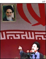 Iranian President Mohammad Khatami underneath a picture of Ayatollah Khomeini