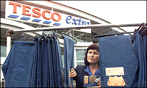 A Tesco shop assistant with Levis jeans at a Tesco store in Newcastle