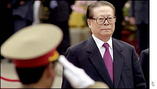 Chinese President Jiang Zemin inspects a military parade