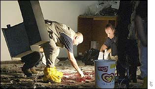 Police scour the inside of the cafeteria where the bombing took place
