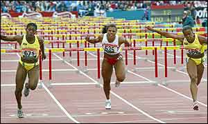 Lacena Golding-Clark beat Jamaican team-mate Vonette Dixon to the line in the women's 100m hurdles.