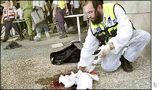 Orthodox Jew medic mops blood from the ground