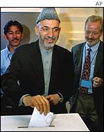 Interim leader Hamid Karzai voting