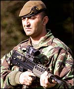 Soldier with SA80 rifle