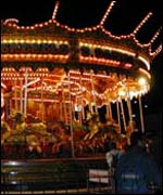 A fairground ride on Bournemouth pier at night