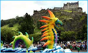 A giant inflatable dragon leads a parade during the Edinburgh Festival