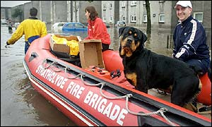 Man and dog in fire service inflatable