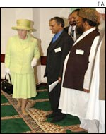 The Queen removed her shoes in accordance with the Muslim religion