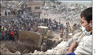 Palestinian looks on as a bulldozer excavates bodies in Jenin