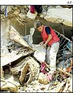 Palestinian boy in debris in Jenin