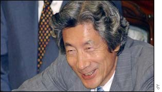 Japanese Prime Minister Junichiro Koizumi smiling at the end of the year's Diet session