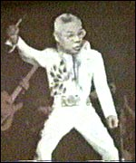 Colin Powell as Elvis