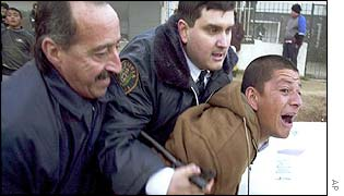 Man being arrested on Thursday