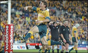 Mat Rogers celebrates scoring for Australia after 72 minutes