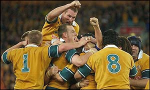 Australia players celebrate their dramatic win over New Zealand