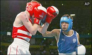 England's Darran Langley is narrowly beaten to light flyweight gold by Indian Mohammed Ali Qamar