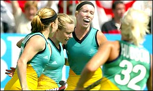 Katrina Powell of Australia is congratulated after scoring in the bronze medal play-off match; Australia won 4-3 against New Zealand