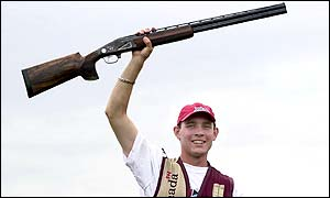 Canadian Clayton Miller enjoys his victory in the men's skeet singles final