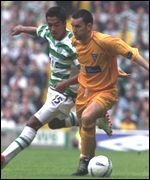 Bobby Petta puts pressure on Lee Dair