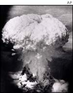 A mushroom cloud rises over Nagasaki on 9 Aug, 1945