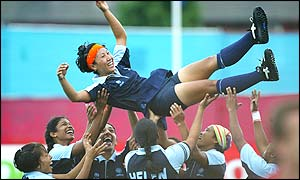 India's Surja Waikhom is thrown up into the air as India celebrate Mamta Kharab's winning golden goal