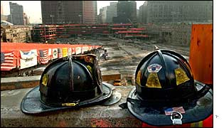 Firefighter hats overlook Ground Zero