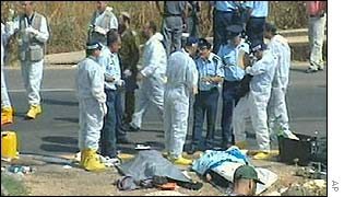 Workers near site of bus bombing